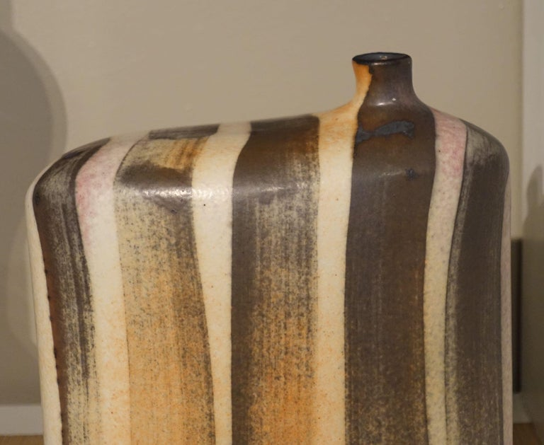 Contemporary vertical brown and cream stripe vase with small spout