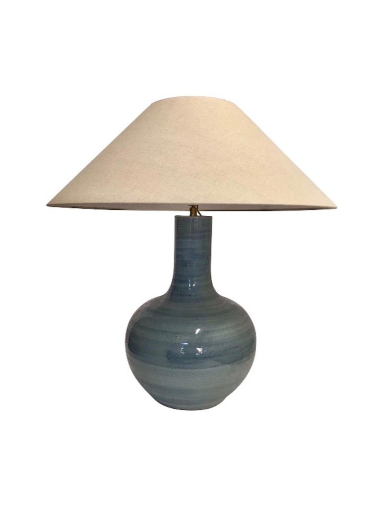 Pair of large blue terracotta thin neck lamps. Horizontal brush pattern. Measures: Overall height including shade 28