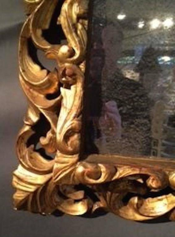 Ornately Carved Gold Giltwood Mirror, France, circa 1830 In Excellent Condition For Sale In New York, NY