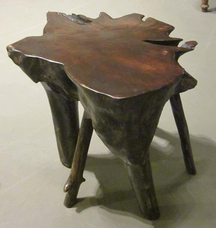 Contemporary Indonesian lychee wood multi leg cocktail table.