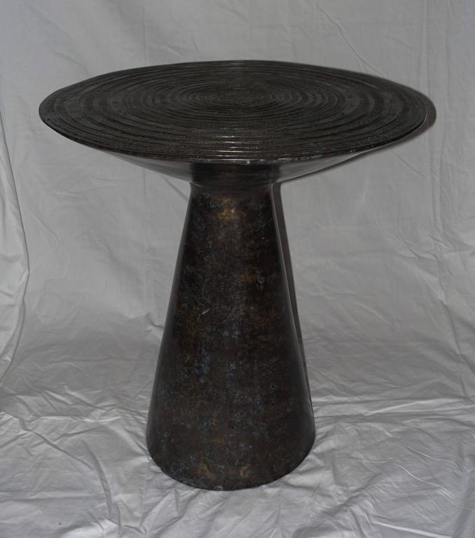 Contemporary Cambodian bronze round side table.
