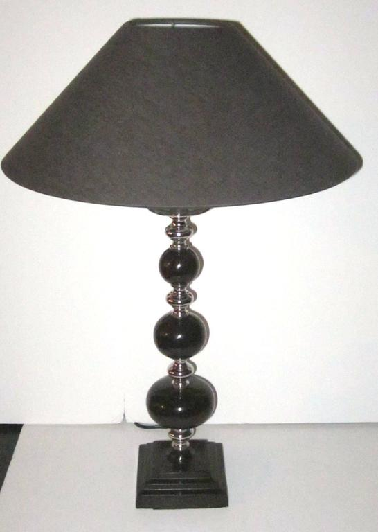 Contemporary pair of dark brown ball with chrome trim table lamps.