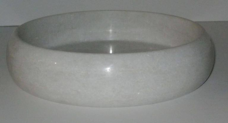 Contemporary Indian round marble tray with high sides.