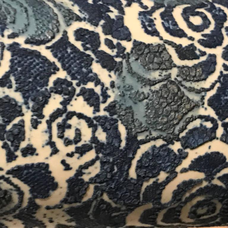 Cylinder shape overall large indigo floral design pattern.