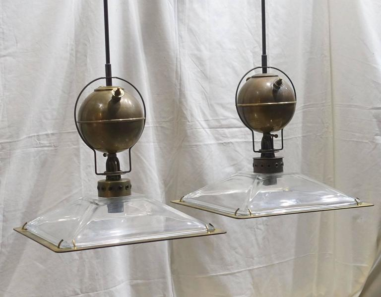 Italian very decorative pair of Industrial light fixtures. Note the decorative brass details and square glass shades with metal trim. Metal rod and cap are included. Fixture only height is 15