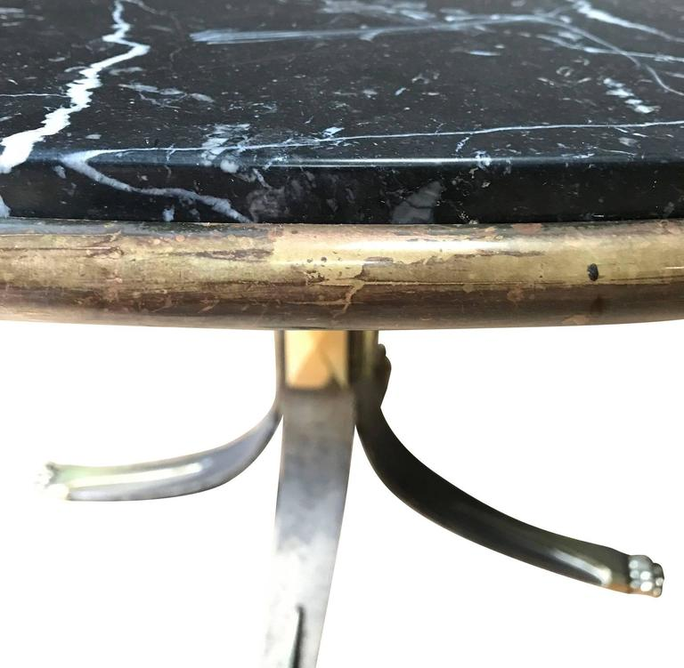 Mid-Century French unusual natural steel base with black or white vein marble top side table. Can also use as a centre hall table. Brass apron. Brass claw feet. Brass details on pedestal base.