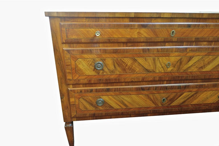 19th century Italian beautifully polished inlaid walnut three-drawer commode.