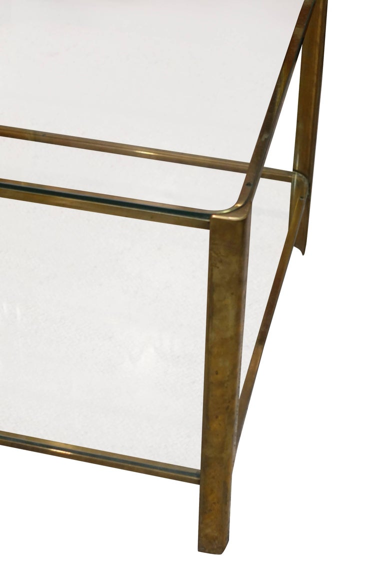 1960s French Jacques Quinet for Malabert two-tiered glass top bronze base coffee table.