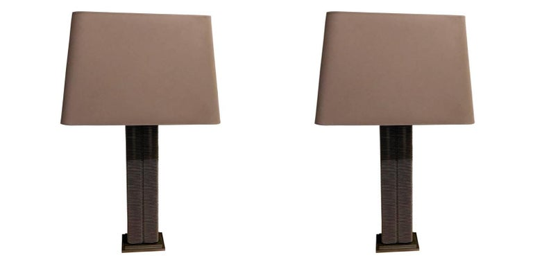 1960s Belgian pair radiator parts converted to lamps on steel base.
