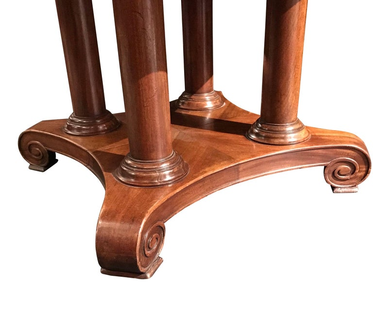 19th Century French, mahogany table that would make a great center hall table or a side table. Note the four columns and the varied finish on the four sections of the base.