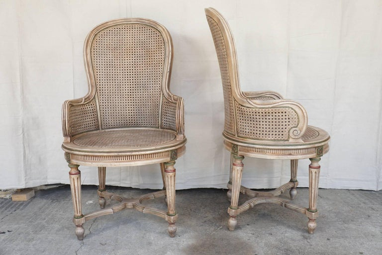 These chairs are manufactured and hand decorated in Chicago as per a metal label on the under side. Made circa 1960 or 1970 they have a lovely old world look and are sturdy and in good shape with no damage or breaks. The chairs have generous and