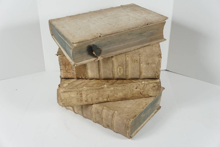 These four books printed in Latin are covered in beautiful old vellum covers and spines. Each book contains text, margin commentary and pictorial illustration to the fronts pages. All but one is from the same library with like beautifully embossed