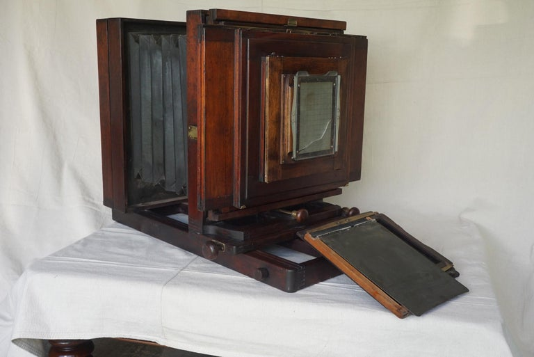 This large format box camera was made by the Folmer & Schwing Division of Eastman Kodak in Rochester NY. The case constructed of mahogany in a rich old red finish has many original details and was being used as a working camera until around 1960.