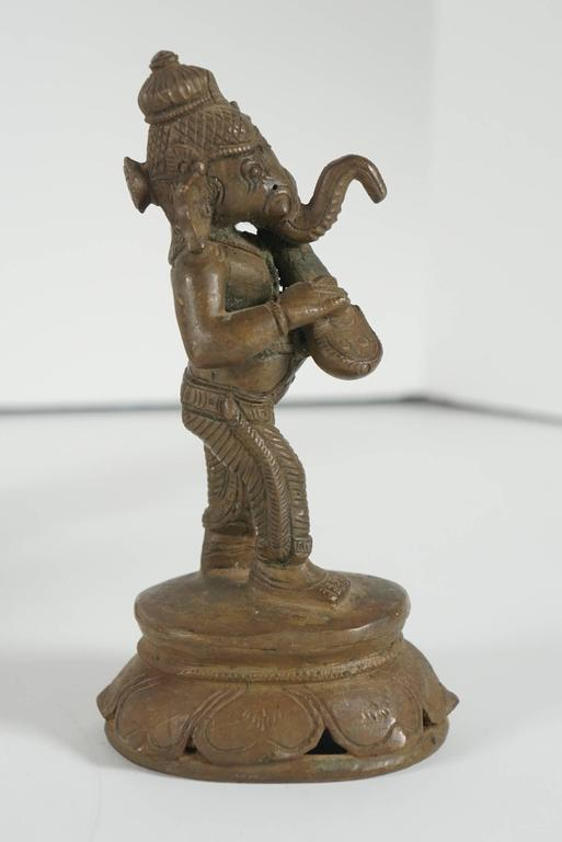 Collection of Five Indian Cast Bronze Figures of Ganesha 8