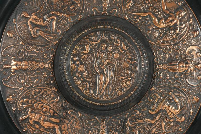 This charger made as an intentional remake of a famous object is fully embossed on the back as such and contains the makers name. The charger contains many different scenes from antiquity but is centered with a scene from the life of Christ with the