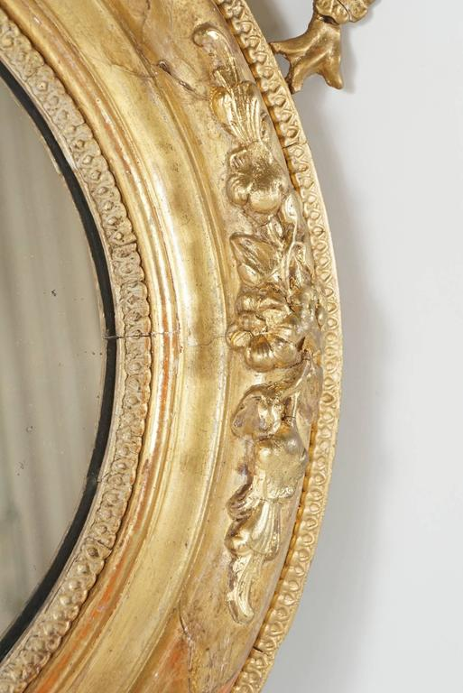 Victorian Oval Gilded Rococo Revival Mirror In Good Condition For Sale In Hudson, NY