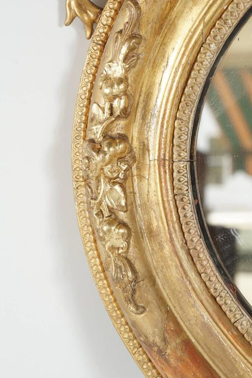 19th Century Victorian Oval Gilded Rococo Revival Mirror For Sale
