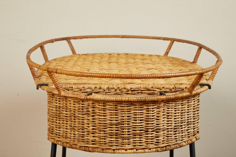 Rattan and painted black metal with removable basket at side.