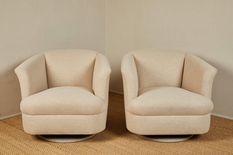 Vintage chairs newly upholstered in white wool flannel suiting fabric.