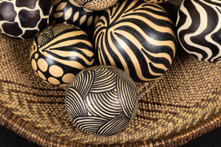 Contemporary Group of 20 Zambian Painted Gourds and Basket For Sale