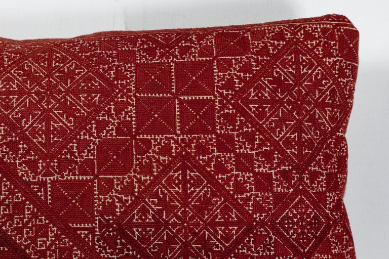 Antique Moroccan textile from the city of Fez. Intricate all-over silk floss on linen embroidery produces a durable fabric. The designs are based on centuries old Mehndi (henna hand tattoo) designs. Backed with natural linen. Feather and down fill,