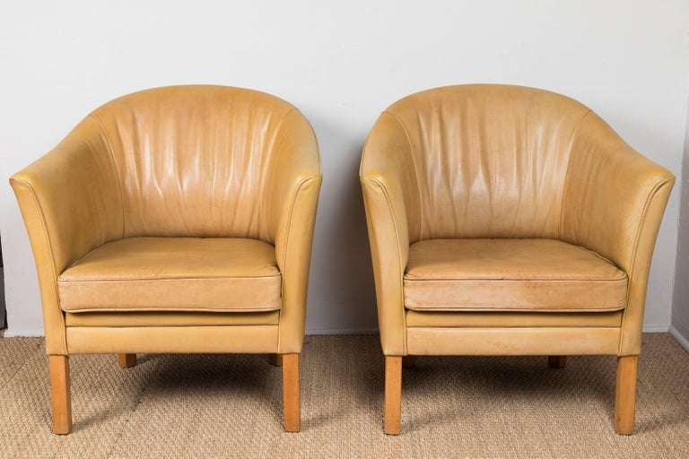Slightly distressed, vintage honey colored leather chairs.  Sold individually. Offered at Pat McGann Gallery.