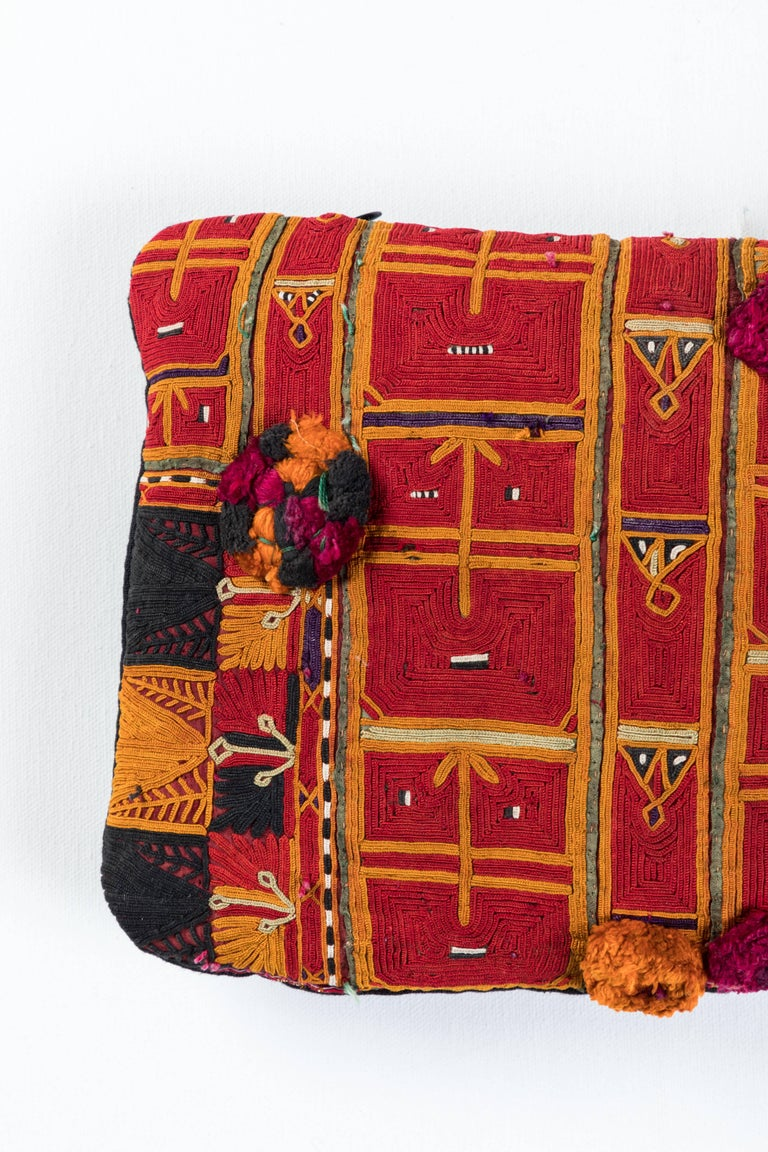 Pat McGann Workshop Pillow made using vintage Pastun tribal embroidery. Afghanistan. Intricate cotton floss all-over stitching with cotton tassels. Black linen back feather and down fill and invisible zipper closure.