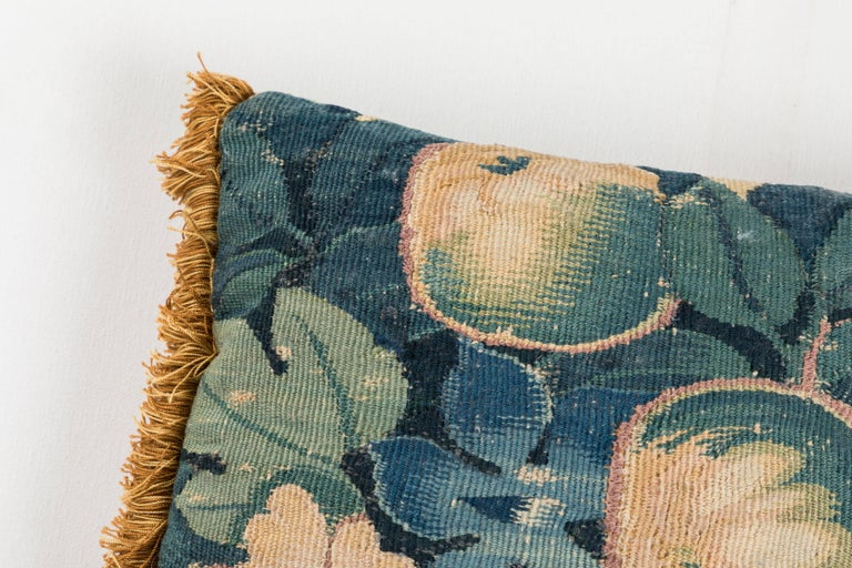 18th century Flemish tapestry fragment pillow with silk trim at two sides. Teal velvet back.   Offered by Pat McGann Gallery.