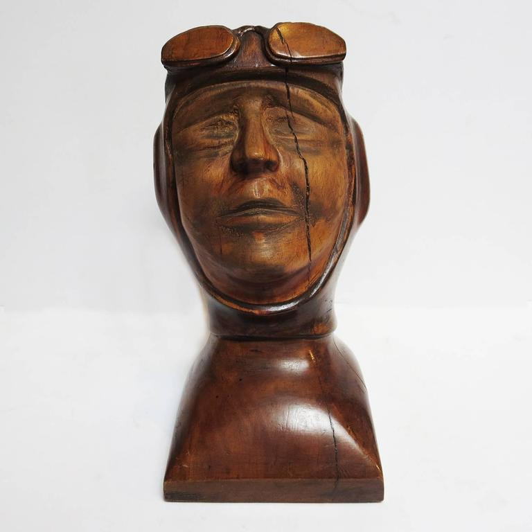 This wonderful bust is unsigned, but the artist was obviously highly skilled. The aviator is tilted back, perhaps in a