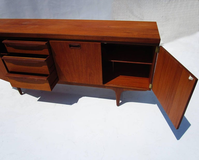 A lovely Classic design with great function. The entire cabinet is storage space, from the drawers to the open spaces. Ideal for an office or dining room. Good condition with a previous refinish. Some water marks to the top side.