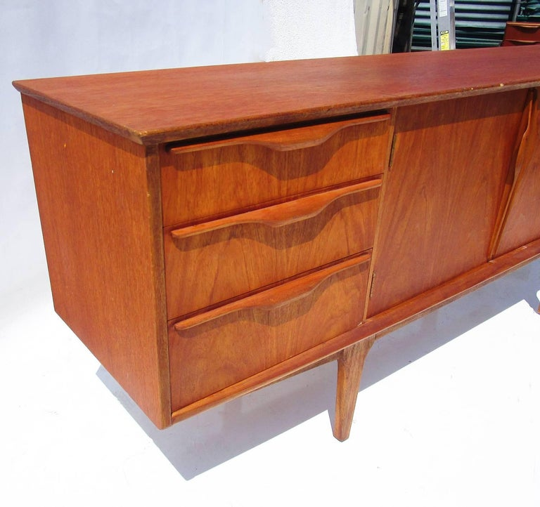 A Classic and clean design with ample storage and good original finish. Designer unknown.