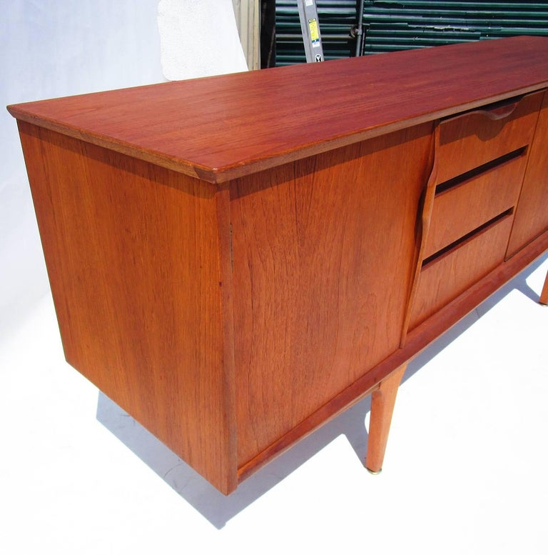 A Classic and clean design featuring tree drawers and three cabinet spaces for storage. Nice original condition.