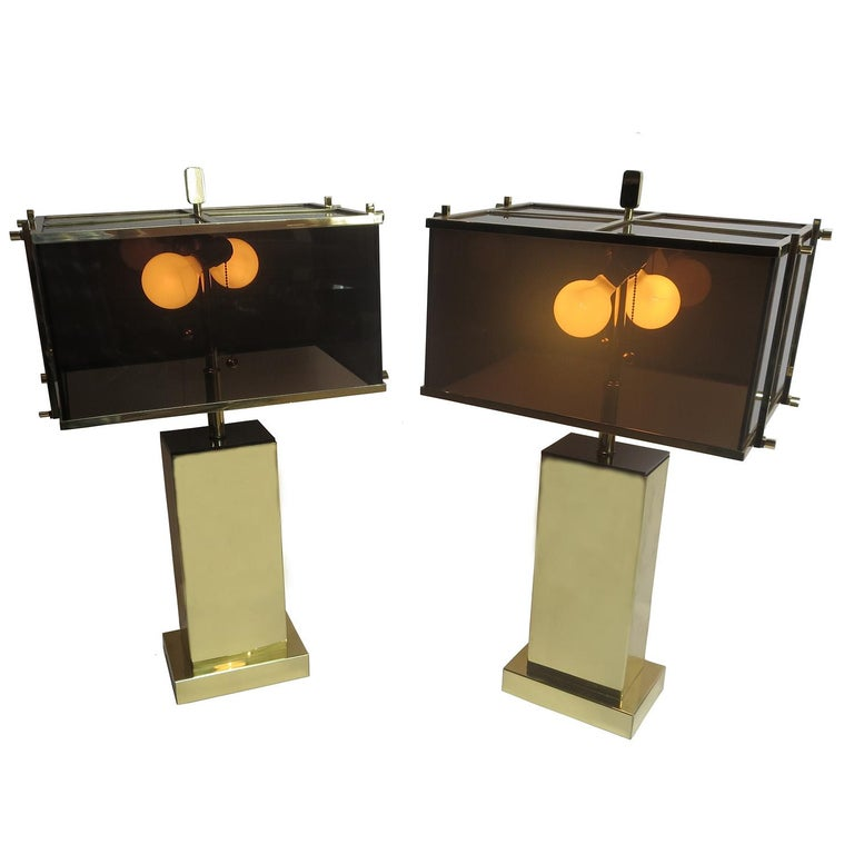 "These stylish ""Edison"" table lamps were designed by Charles Hollis Jones in 1971. They were offered in chrome with clear acrylic shades, or in brass with the smoked acrylic shades, as shown here. The lamps are in excellent original condition, and"