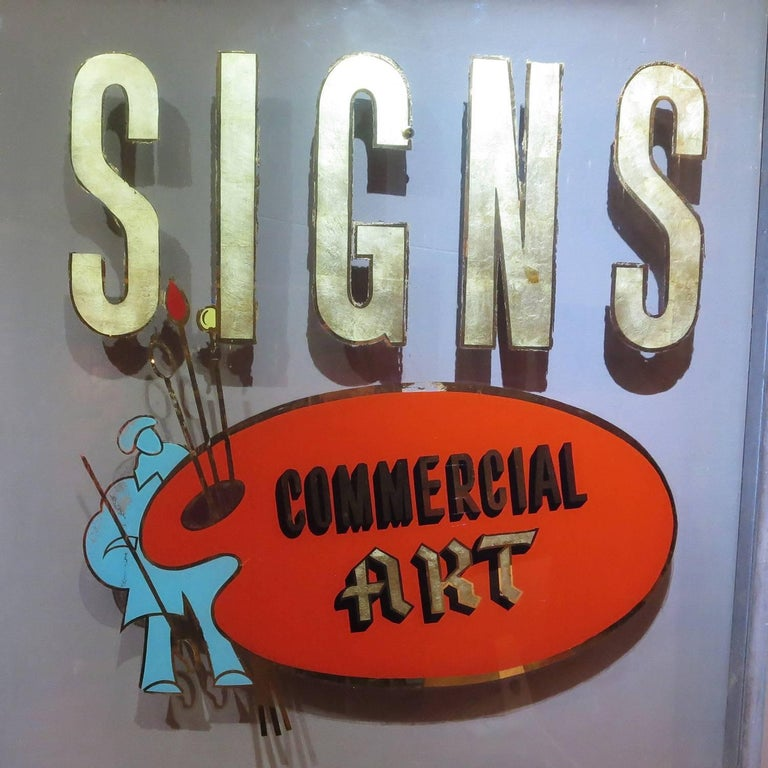 Truly a dying art, the local sign painter has become a thing of the past. This fantastic framed window was an advertisement that hung in a sign painters shop. The large letters are gold leaf, trimmed in gold mirror. The palette and artist are the