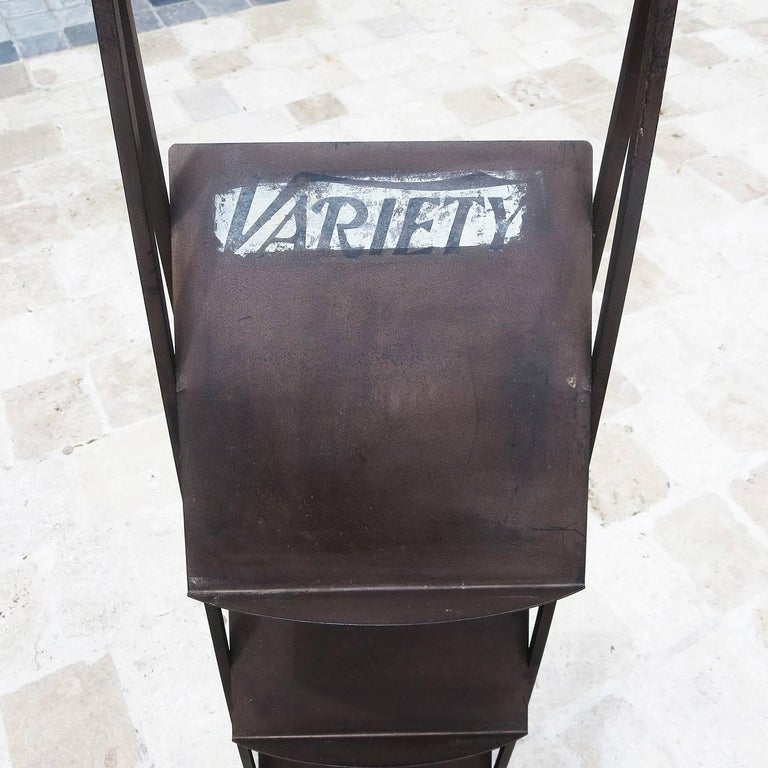 Variety magazine, founded in 1905, was the main conduit for all information on the film trade in Hollywood. This iron stand was provided by Variety to the Ambassador Hotel (1921-2005) in Los Angeles. The Ambassador was the center of Hollywood