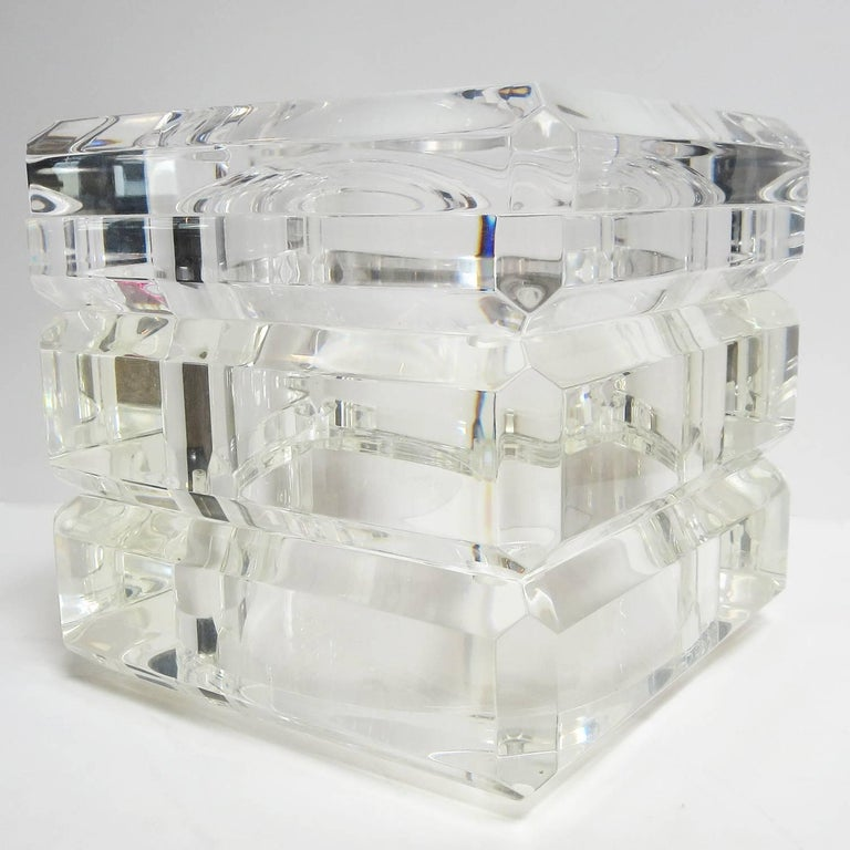 This wonderful sculptural ice bucket was designed by Italian designer Alessandro Albrizzi in the 1970s. It is heavy and solid, with a swiveling removable lid. It is in very nice original condition, with only minor lines where the swivel top passes.