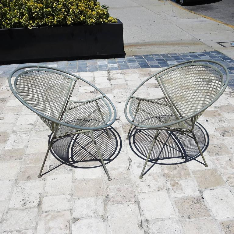 """Referred to as the """"Radar Hoop"""" or """"Clamshell"""" chairs, this great design was one of the most iconic of the Mid Century era. Ours are in original finish of verdi gris bronze paint, and look sensational! Both chairs are in excellent condition, without"""