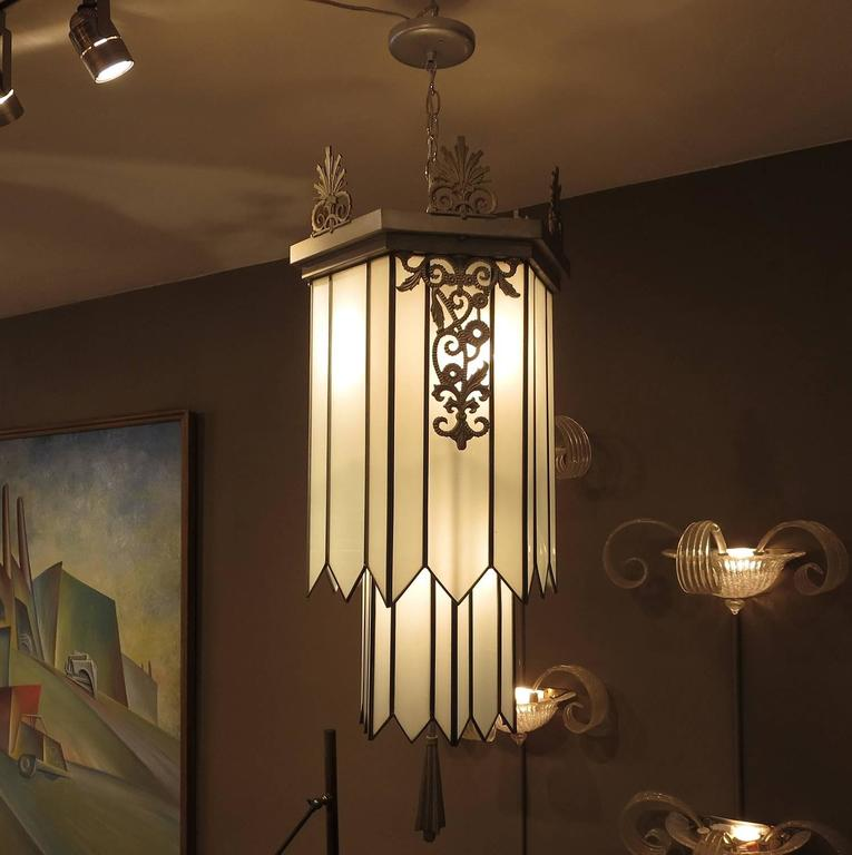 When one thinks back to the 1930s Great Depression, the movie palaces built in the day were escapes of fantasy and opulence. The Art Deco interiors were ultra-glamorous and transported the average person from difficult times. This chandelier is