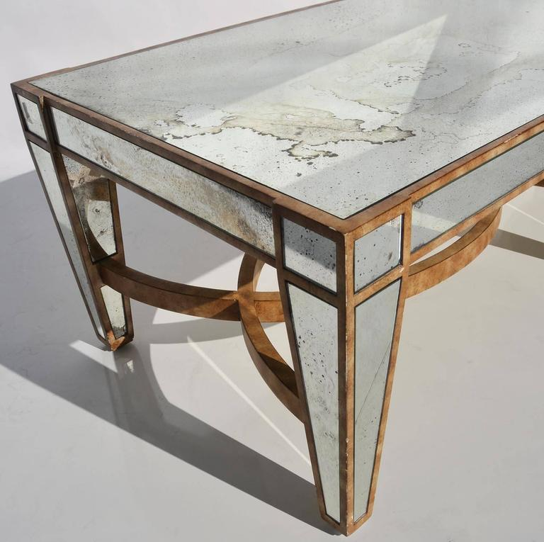 Hollywood Regency Coffee Table in Antiqued Mirror In Good Condition For Sale In Los Angeles, CA