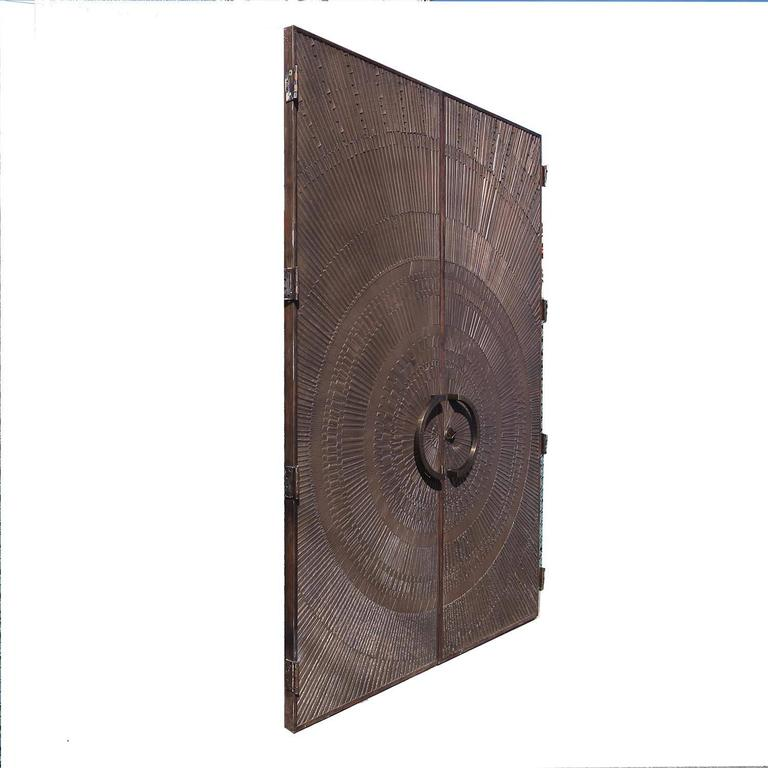 "Massive ""Heroic Sunburst"" Double Sided Bronze Doors by Forms + Surfaces 2"