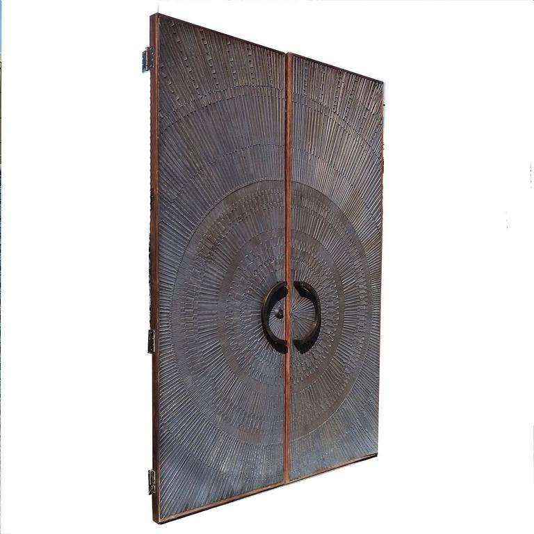 "Massive ""Heroic Sunburst"" Double Sided Bronze Doors by Forms + Surfaces 9"