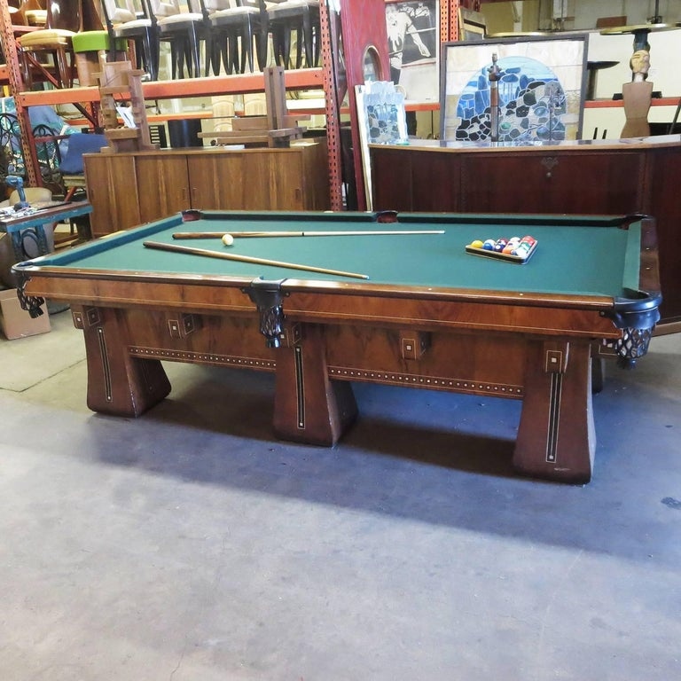 One of the finest pool tables ever created by the Brunswick Balke Collendar company was the Arcade model. The super deluxe version featured six legs instead of four, for extra stability and balance. These were considerably more expensive in the day,