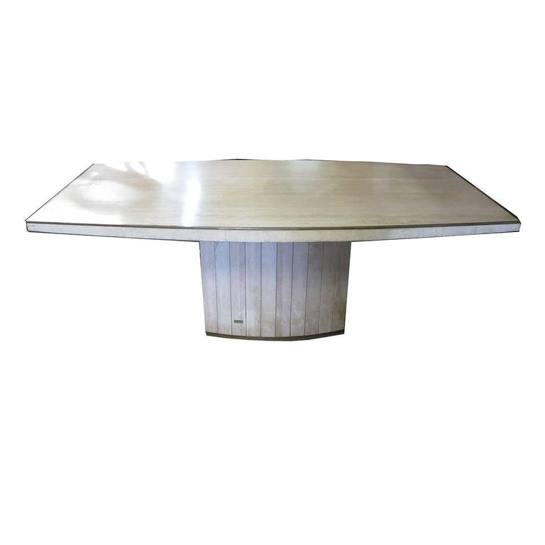 This beautiful and classic design was executed in travertine marble with brass accents. The table retains original Jean Charles Company brass label. The scale is well suited for any interior home or office space.