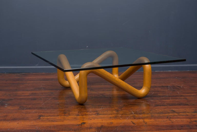 Rare sculptural coffee table designed by Harvey Probber. Made from knotted oak with a square glass top.