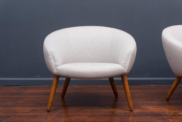 Nanna Ditzel model AP 26 lounge chairs made by AP Stolen, Denmark. Newly upholstered with oak legs, very comfy.