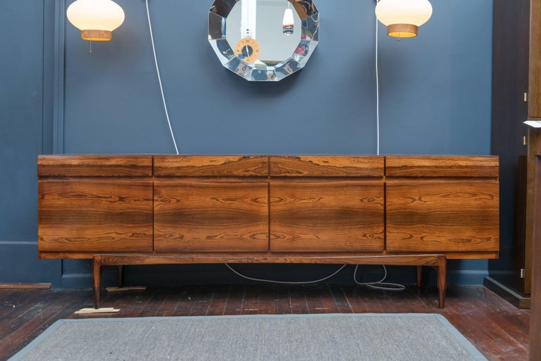 I.B Kofod-Larsen design rosewood credenza, perfectly refinished with adjustable shelves and drawers.