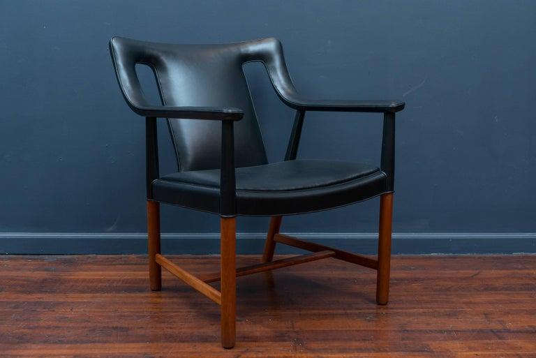 Ejner Larsen and Askel Bender Madsen design teak lounge chair model LP48 for Ludvig Pontoppidan, Denmark. Perfectly re-upholstered in new Italian black leather, labelled.