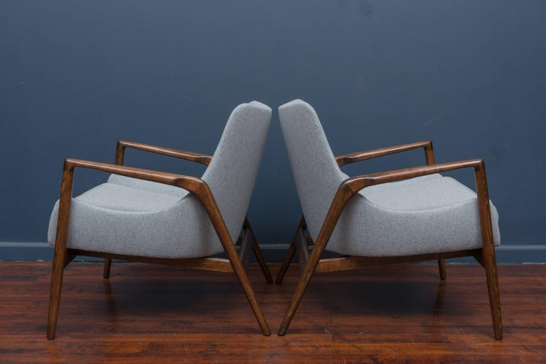 Pair of Ib Kofod-Larsen design lounge chairs, newly refinished and upholstered.
