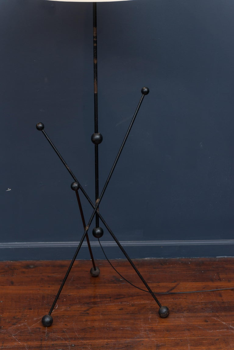 Midcentury black lacquer and steel floor lamp, newly rewired and ready to enjoy. Patina to metal and wooden balls throughout, possibly French in origin. Shade not included.
