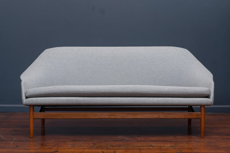 Ib Kofod Larsen design settee or small sofa for Carlo Garhn, Denmark, 1957. Newly upholstered and refinished.